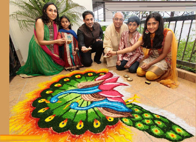 PHOTO OF GIRLS MAKING THE RANGOLI
